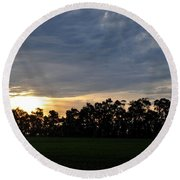 Sunset Over Farm And Trees Round Beach Towel