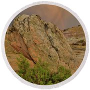 Sunset Storm Over Bentonite Site Boulders Round Beach Towel