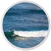 Surfing At Honolua Bay Round Beach Towel