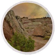Tail End Of Storm At Sunset Over Bentonite Site Round Beach Towel
