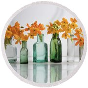 the Blooming yellow Ornithogalum Dubium in a transparent bottle instead vase Round Beach Towel