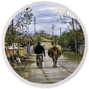 The Cow Herder Round Beach Towel
