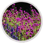 The Flowers And The Bees Round Beach Towel