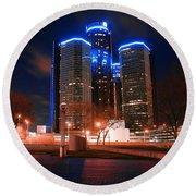 The Gm Renaissance Center At Night From Hart Plaza Detroit Michigan Round Beach Towel