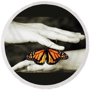 The Hands And The Butterfly Round Beach Towel