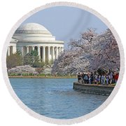 The Jefferson Memorial With Cherry Blossoms And A Lot Of People Round Beach Towel