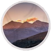 The Last Light Of The Day Over Snowdon. Round Beach Towel