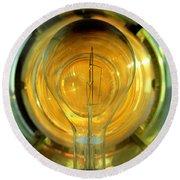 The Light Bulb Inside The Fresnel Of A Lighthouse Round Beach Towel