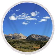 The Lonely Mountains Round Beach Towel
