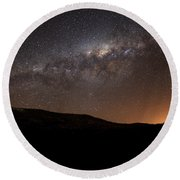The Milky Way Setting Behind The Hills Round Beach Towel