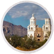 The Mission And The Mountains Round Beach Towel