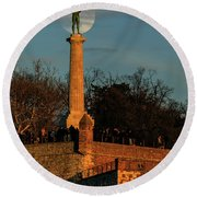 The Moon Rising Behind The Victor Statue In Belgrade In The Golden Hour Round Beach Towel