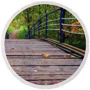 the old bridge over the river invites for a leisurely stroll in the autumn Park Round Beach Towel