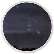 The Orion Constellation Rises Round Beach Towel