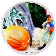 the Pumpkin and the Scarecrow Round Beach Towel