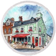 The Red Boat In Beaumaris Round Beach Towel