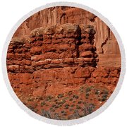 The Red Wall Round Beach Towel