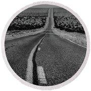 The Road To Shoshone Round Beach Towel