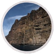 The Rocks Of Los Gigantes 1 Round Beach Towel