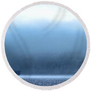 The Sea Mist Lifts To Reveal The Great Orme Behind Llandudno Pier Round Beach Towel