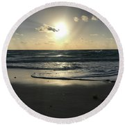 The Sun Is Rising Over The Ocean Round Beach Towel