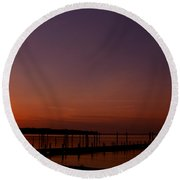 The Sun Sets Over The Water Round Beach Towel