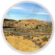 The Winding Road In Central Oregon Round Beach Towel