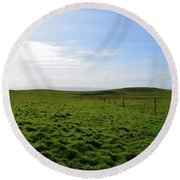 Thick Grass Field Abutting The Cliff's Of Moher In Ireland Round Beach Towel