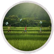 Three Boys Are Happy To Play Kites At Summer Field In Nature In  Round Beach Towel