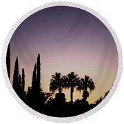 Three Palms In California At Sunset Round Beach Towel