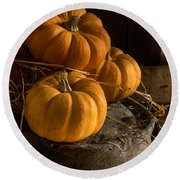 Three Pumpkins On A Bucket Round Beach Towel