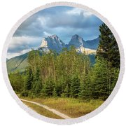 Three Sisters And A Dirt Road Round Beach Towel
