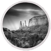 Three Sisters Formation At Monument Valley Round Beach Towel