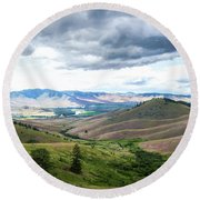 Thunderclouds Over The Hills Round Beach Towel