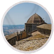 Tile Roof Tops Of Volterra Italy Round Beach Towel