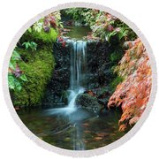 Tiny Waterfall In Japanese  Garden.the Butchart Gardens,victoria.canada. Round Beach Towel