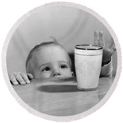 Toddler Reaching For Glass Of Milk Round Beach Towel