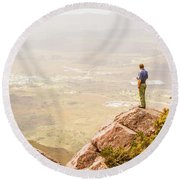 Tourist On The Tip Of Western Tasmania Round Beach Towel