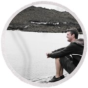 Tourist Seated At Dove Lake Lookout In Tasmania Round Beach Towel