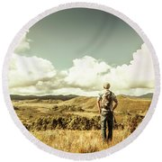 Tourist With Backpack Looking Afar On Mountains Round Beach Towel
