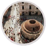 Tourists At Dubrovnik's Onofrio's Fountain Round Beach Towel