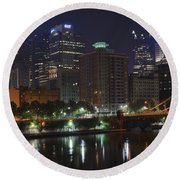 Towering Over The River Round Beach Towel