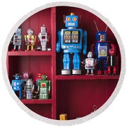 Toy Robots On Shelf  Round Beach Towel by Garry Gay
