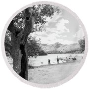 Tree And People By The Lake Round Beach Towel
