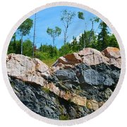 Trees Above The Pink And Grey Rock  Round Beach Towel