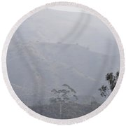 Trees In Early Morning Mist With Tower  Round Beach Towel