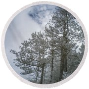 Trees On A Hillside Round Beach Towel