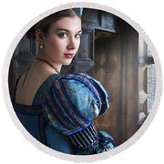 Tudor Woman With Puffed Sleeves And French Hood Facing A Window  Round Beach Towel