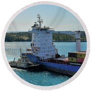 Tugboat Helping Container Ship Out Of Harbor Round Beach Towel