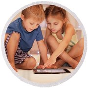 Two Happy Children Playing On The Tablet Round Beach Towel